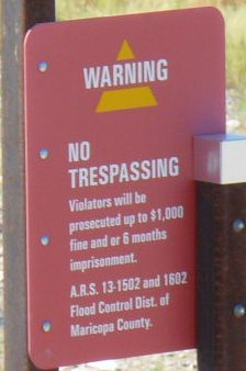 No trespassing sign at Tempe Cesspool for the Arts
